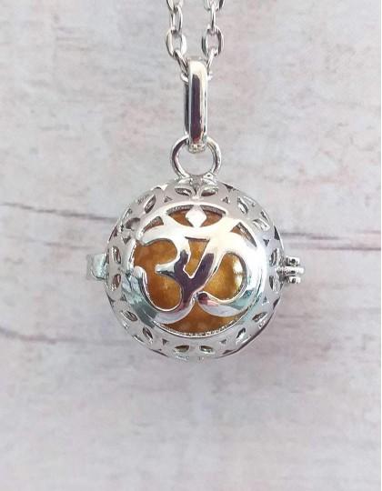Chamador de Anjos (esfera dourada) - Om